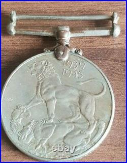 Original 1939-1945 World War II Service War Medal with Ribbon, George VI